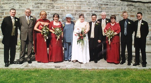 Me with my husband, parents & 8 older siblings on my wedding day 19th August 2000